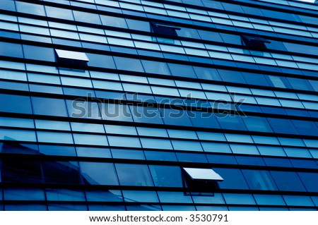 Windows of a modern building (blue tone)