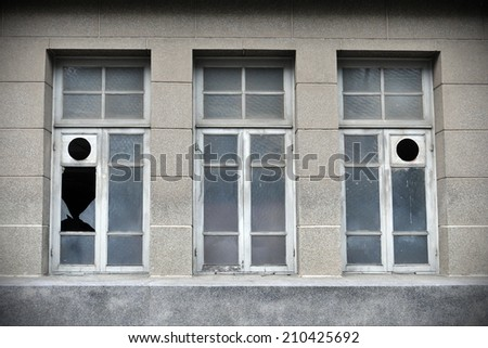 Windows of an Old Derelict Building - stock photo