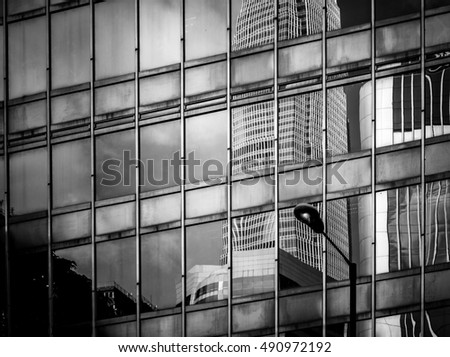 windows of business building with B&W color
