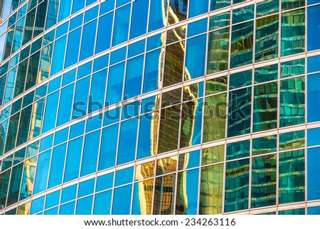 Windows of modern building toned in blue and green colors. - stock photo