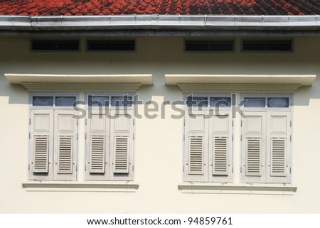 windows of old classic building - stock photo