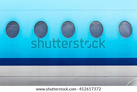 Windows of the blue airplane - copy space - stock photo