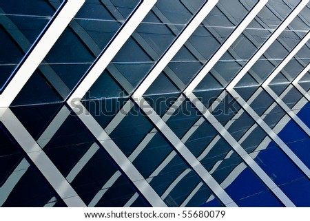 windows on a modern office building making a background pattern effect - stock photo