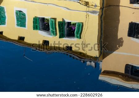 Windows reflexions on sea water at Veli Losinj - Croatia - stock photo