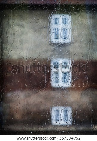 Windows view through a wet window. Soft focus on drops to add pictorial impression  - stock photo