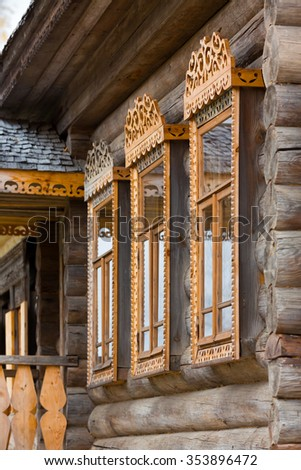 Windows with carved wooden trims in Museum of Russian Wooden Architecture