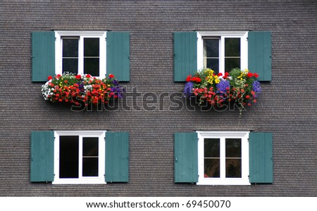 windows with flower decoration - stock photo