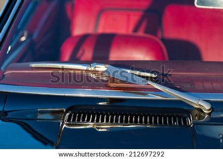 Windscreen and wiper blade of classic American sports car. - stock photo