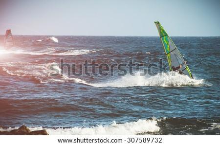 windserfing in ocean - stock photo
