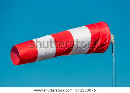 windsock against blue sky - stock photo