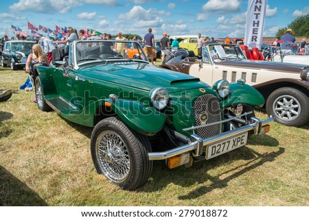 WINDSOR, BERKSHIRE, UK- AUGUST 3, 2014: A Green Panther Kallista on show at a Classic Car Show in August 2014. - stock photo