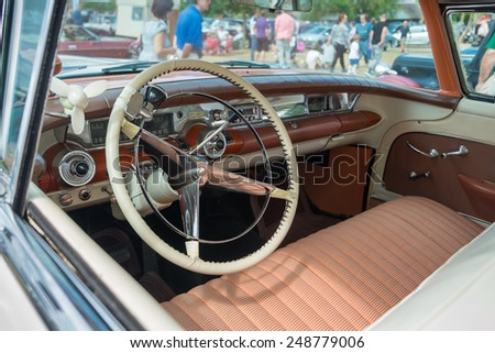 WINDSOR, BERKSHIRE, UK- AUGUST 4, 2013: Interior of a 1958 Buick Limited Classic car on show at Windsor Farm Shop International Classic Car Show in August 2013 - stock photo