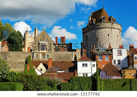 Windsor castle above the town houses - stock photo