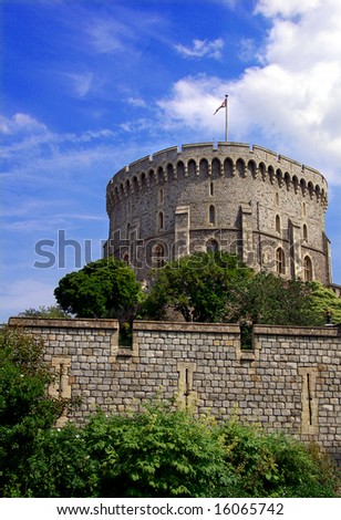 Windsor Castle, tower and wall against blue sky and clouds - stock photo