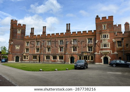 WINDSOR, ENGLAND - JUNE 11, 2015: Exterior Facade of Historic Eton College, a Boarding School for Boys, with Blue Sky and Clouds, Berkshire, England on June 11, 2015