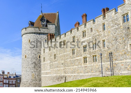 WINDSOR, ENGLAND - MAY 27, 2013: Curfew Tower, part of the Lower Ward in medieval Windsor Castle. Windsor Castle is a royal residence at Windsor in the English county of Berkshire. - stock photo