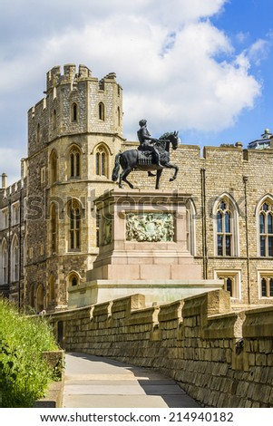WINDSOR, ENGLAND - MAY 27, 2013: View of Upper Ward (Quadrangle) in Medieval Windsor Castle. Windsor Castle is a royal residence at Windsor in the English county of Berkshire. Statue of Charles II. - stock photo