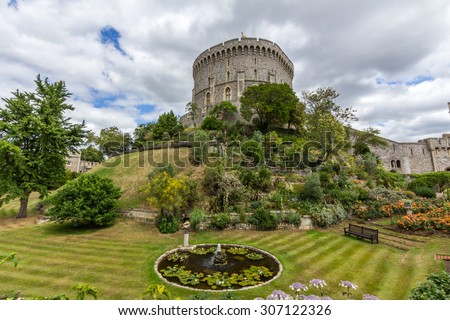 WINDSOR, UK - JULY 18, 2015: Round tower of Windsor Castle. It is a royal residence at Windsor in the English county of Berkshire. The castle is notable for its architecture. - stock photo