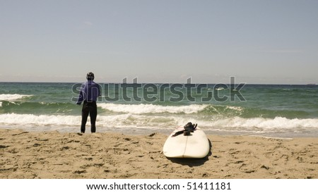 Windsurfer having a break at the beach