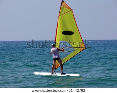 Windsurfer in the sea - stock photo