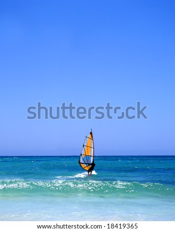 Windsurfer off the coast of Fuerteventura, one of the Canary Islands, in the Atlantic Ocean - stock photo
