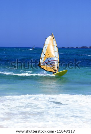 Windsurfer on Lanzarote, Canary Islands in a turquoise sea with white surf - stock photo