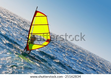 Windsurfer playing on the beach