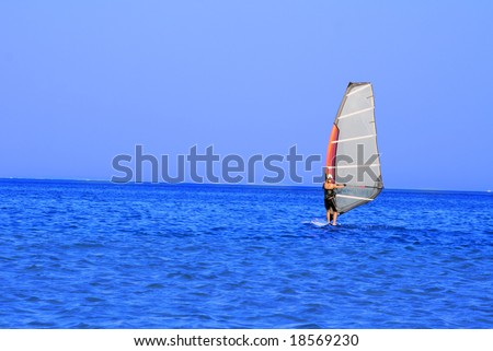 Windsurfer sailing onthe sea. Space for text.