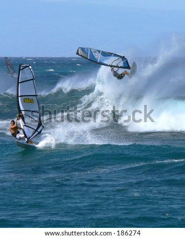Windsurfers find big waves at the north shore, Maui. - stock photo