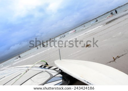 windsurfers getting ready to race and surf on the beach in the maharees county kerry ireland - stock photo