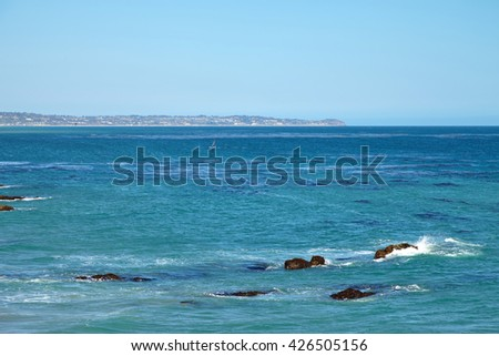 Windsurfing on a very choppy sea in Southern California Malibu - stock photo