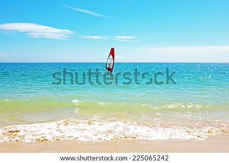 Windsurfing on the atlantic ocean near Lagos Portugal - stock photo