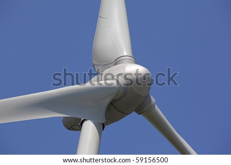 WindTurbine with blue sky and clouds - stock photo