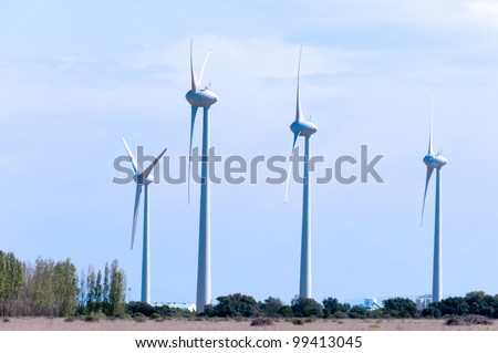 windturbines conducting electricty on an open field