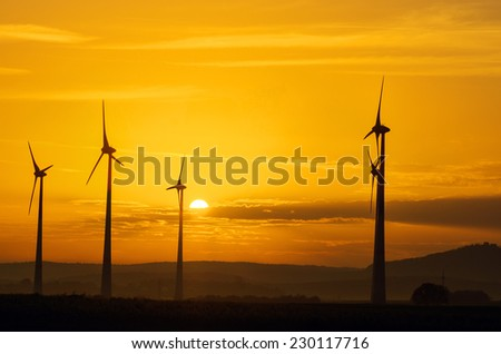 Windwheels and a beautiful sunset seen in rural Germany