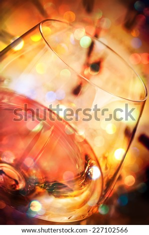 Wine and blurred clock in the background - stock photo