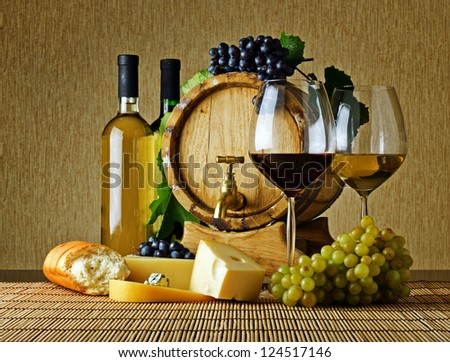 Wine and cheese on the table - stock photo
