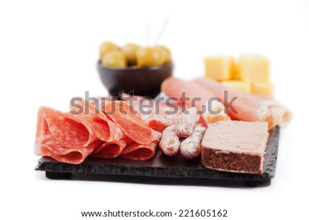 Wine and Cheese Platter. Charcuterie assortment and olives on white background - stock photo