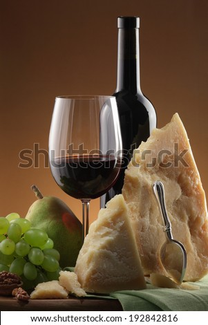 Wine and cheese still life, fruits on the background - stock photo