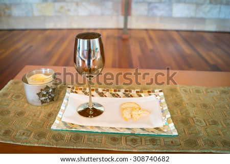 Wine and communion bread represent the body and blood of Jesus Christ. - stock photo