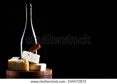 Wine and fresh cheese on the table - stock photo