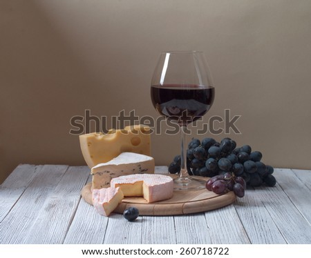 Wine and fresh cheese on the table