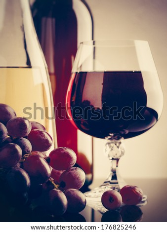 Wine and grape. Winery still life on the glass with reflections - stock photo