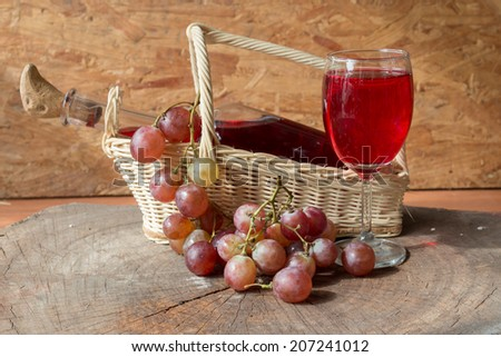 Wine and grapes on old wood.