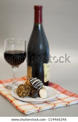 Wine and homemade cookies served on tea cloth - stock photo