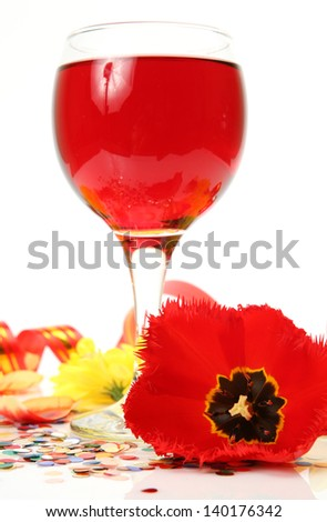 Wine and petals of tulips