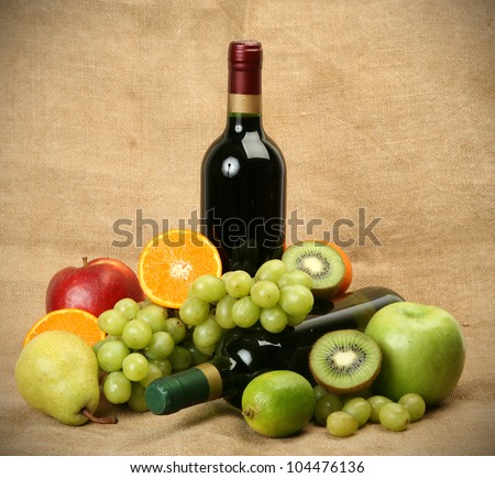 Wine and ripe fruit - stock photo