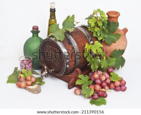 wine barrel and red ripe grape - stock photo