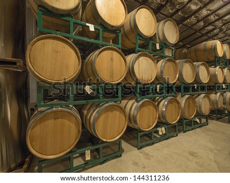 Wine barrels in a cold warehouse - stock photo