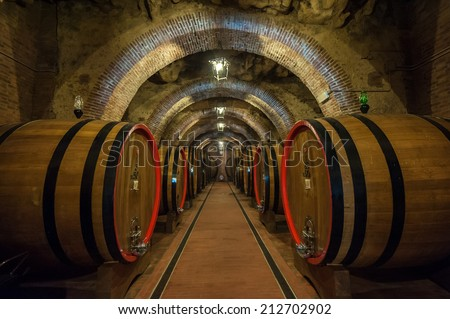 Wine barrels in a Montepulciano cellar, Tuscany - stock photo